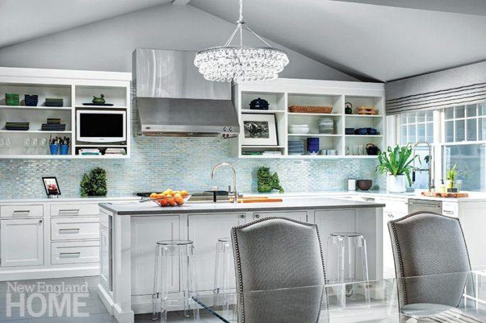 """A dressy chandelier in the kitchen? Why not? """"I'm all about mixing it up-formal with informal, high with low,"""" says homeowner/designer Olga Adler."""