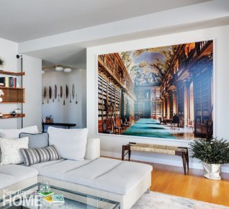 A photograph by Massimo Listri of the Strahov Library in Prague is a nod to the clients' Czech roots and a rococo counterpoint to the apartment's clean lines.