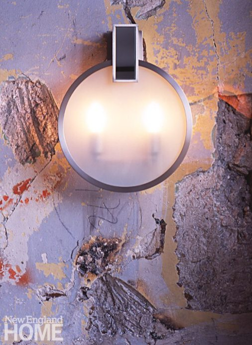The Round Upright Hanging Sconce from the Brockway collection.