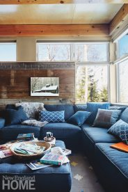The architect created a cozy family room that tucks in behind the living room fireplace.