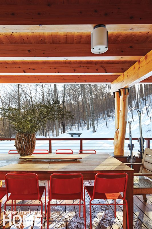An outdoor covered porch projects off the kitchen, giving the homeowners a perfect spot for hot chocolate drinking.