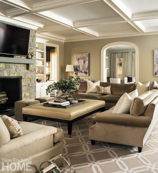 In the family room, the designer satisfied the wife's penchant for neutrals by washing the space in shades of taupe.