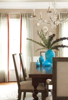An elegant chandelier paired with a more transitional table bridges formality and functionality in the dining room.