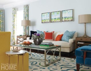 The eye-catching triptych above the sofa is by Darien artist Andrea Bonfils.