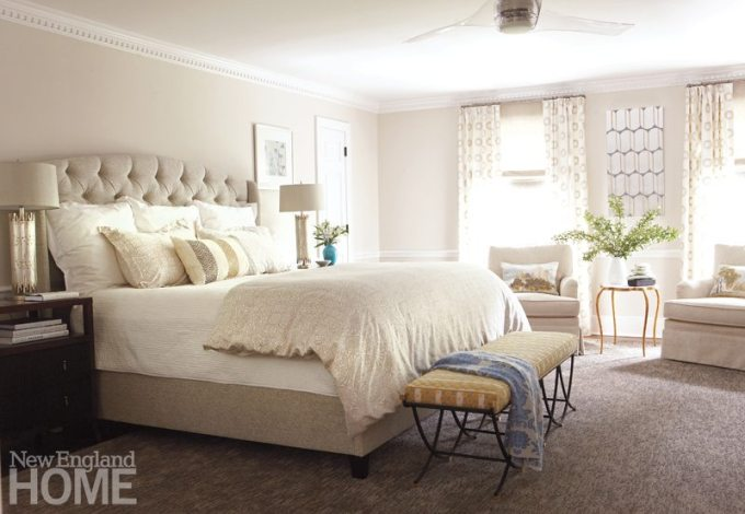 With subtle gold and silver accents and a cozy sitting area, the master suite is a soothing retreat for the homeowners.