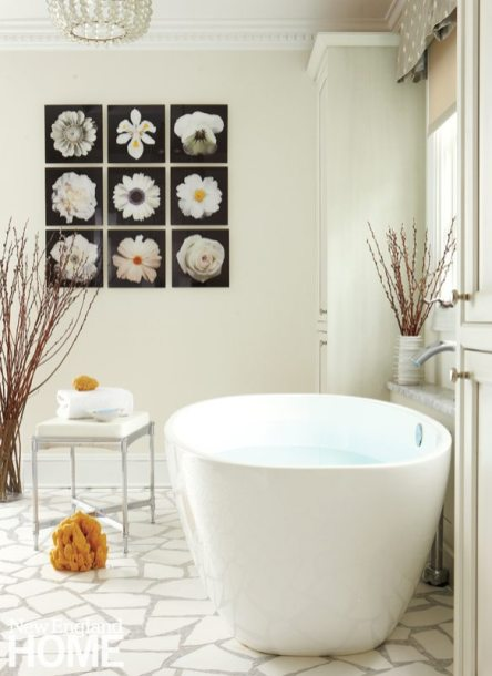 The floor of the master bath, fabricated from Thassos and statuary Carrara marbles, is designed to look like a garden path; the beautiful collection of botanical photos reinforces the theme.