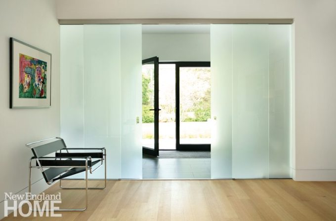 The foyer is enclosed by sliding translucent glass panels that offer privacy, yet still let in plenty of natural light.