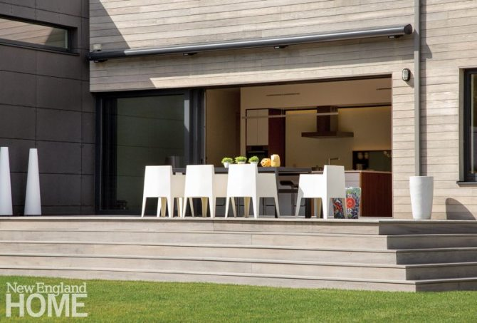 A retractable awning offers shade to both the outdoor dining space and kitchen.