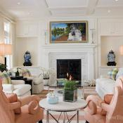 A custom wallcovering underscores the gentle personality of the formal living room.