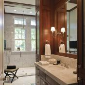 Transoms top the windows in the luxurious mahogany master bath, as throughout the house.