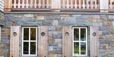 Stone cladding anchors the house to its site.