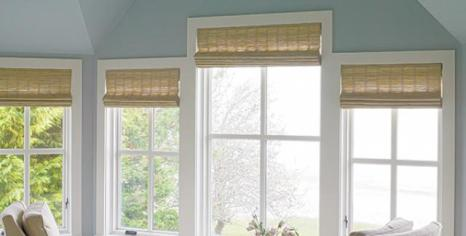 The master bedroom's motorized shades make privacy a snap.