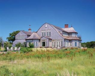 Pale trim and weathered shingles suit the coastal New England site. Traditional hydrangeas fit, too.