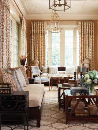 F. Schumacher'€™s Imperial Trellis fabric frames the sunroom's windows.