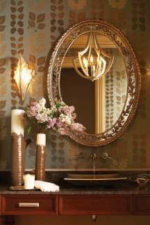 An Art Deco sconce and custom mirror enliven the powder room.