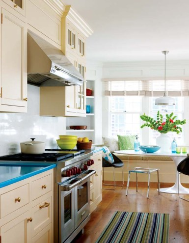 Bright blue on the kitchen counters provides a surprising splash of color.