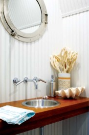 Kathleen designed the powder room's custom floating vanity.
