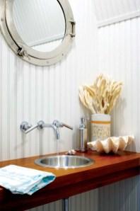 Kathleen designed the powder room's custom floating vanity.