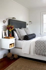 Hay also designed the guest room'€™s gray Ultrasuede headboard and floating bedside tables.