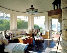 Adjacent to the living room, the porch offers views and a fireplace.