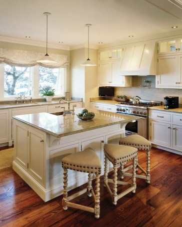 Custom cabinets provide the sunny kitchen with generous storage.