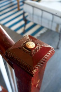 """The newel post's œmortgage button €""""added when long-ago owners finished paying for the house €""""is an antique replacement for the original."""