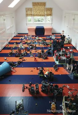 The kids' favorite colors--navy and orange--stripe the playroom floor.