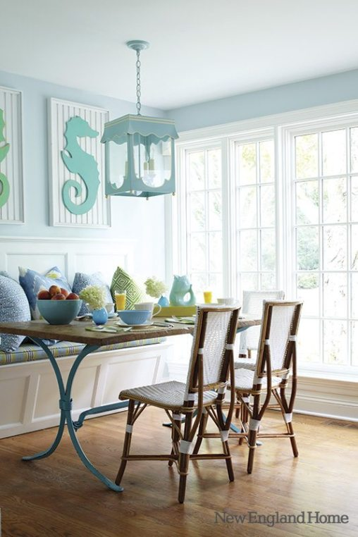 With bistro chairs and seahorses presiding, seaside colors pop in the breakfast area.