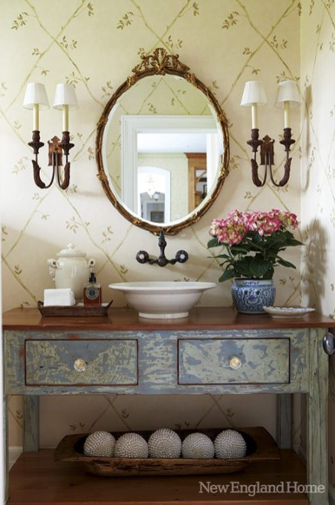 Vintage wooden sconces elevate the powder room.