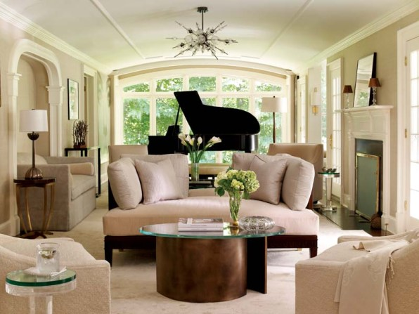Luxuriously upholstered pieces mix cleverly with bronze, acrylic and wood in the living room.