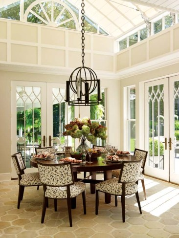 French doors and high windows give the breakfast room the feel of a greenhouse.