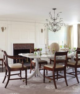 Antique green glass from Della Monica'€™s collection enlivens the dining room.