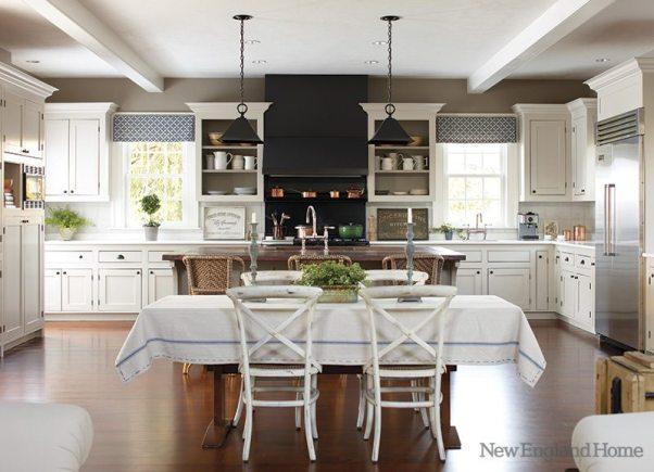 Kitchen amenities include custom pendants and charming linen valances.