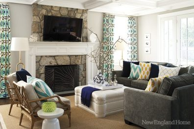 Durable fabrics, including the faux ostrich-print vinyl on the ottoman, are pretty and kid-proof in the family room.