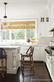 French cafe style barstools bring color and texture to the white kitchen.