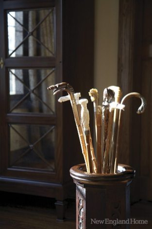 An antique umbrella stand holds old canes designer George Snead found in a Paris shop.