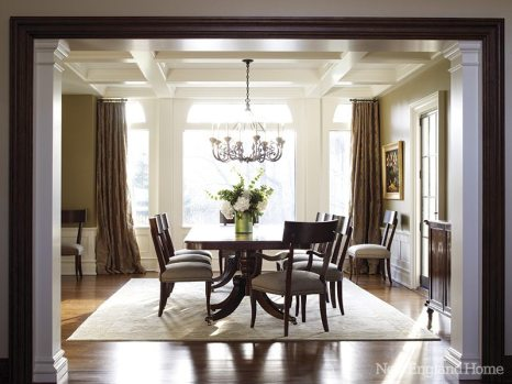 New transitional dining chairs from Hickory Chair surround the homeowners' traditional double-pedestal dining table.