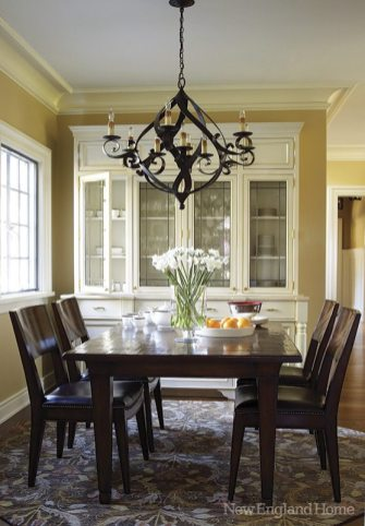 An overscale chandelier brings an arts-and-crafts touch to the breakfast room.