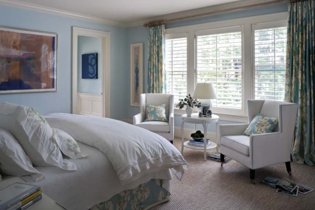 An orchard print adds pattern to the robin'€™s-egg-blue master bedroom.