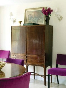 The midcentury modern cabinet is by Kaare Klint.