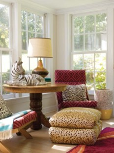 David Hicks fabric pairs with cheetah spots and zebra stripes in the sunroom.