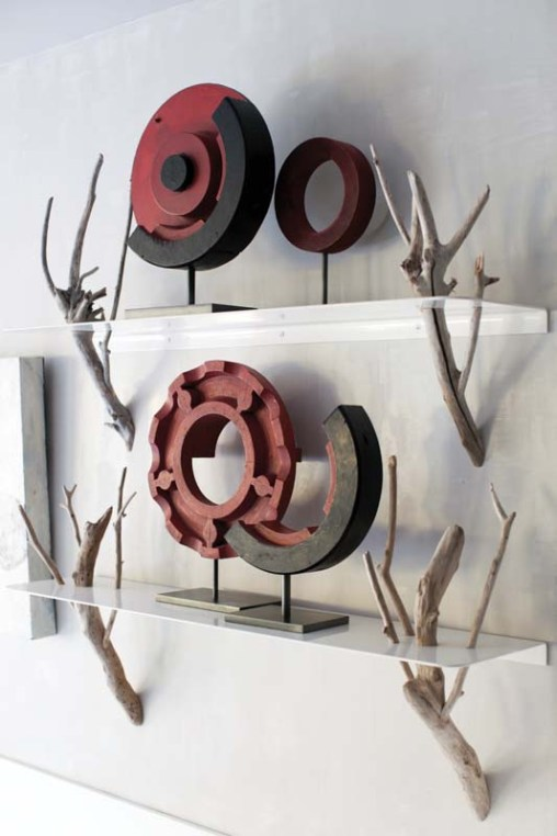 Branches make intriguing brackets to hold decorative objects in the kitchen.