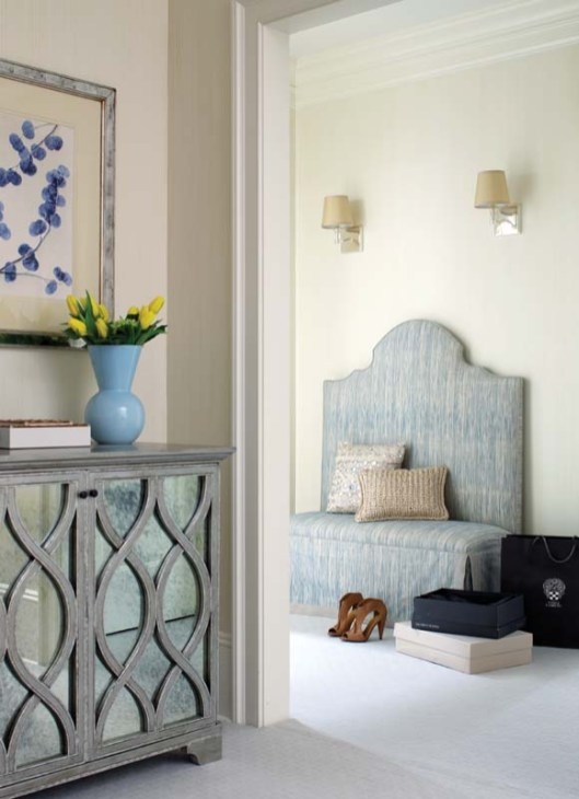 A custom bench in the vestibule gives a preview of the tranquil master suite.