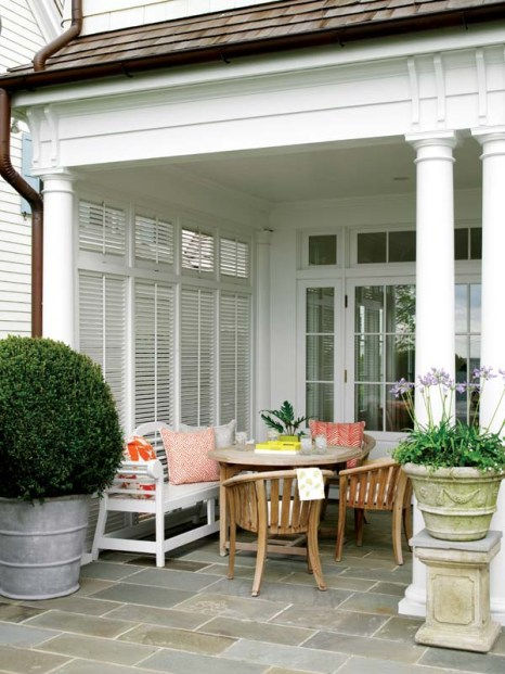 Accessed through French doors and with Bermuda shutters for privacy, an outdoor patio alcove extends the dining area.