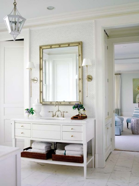 Identical washstands and mirrors face each other in the master bathroom.