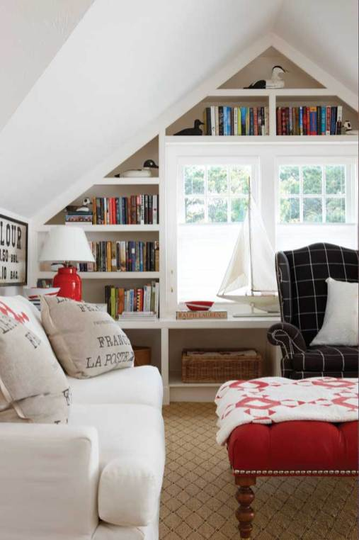 The second-floor loft overlooks the living room and is a treasure trove of books and Americana.