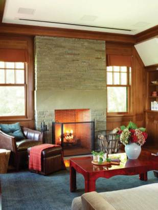 In the spacious family room, the ceiling hides the flat-screen TV, which drops down for viewing.
