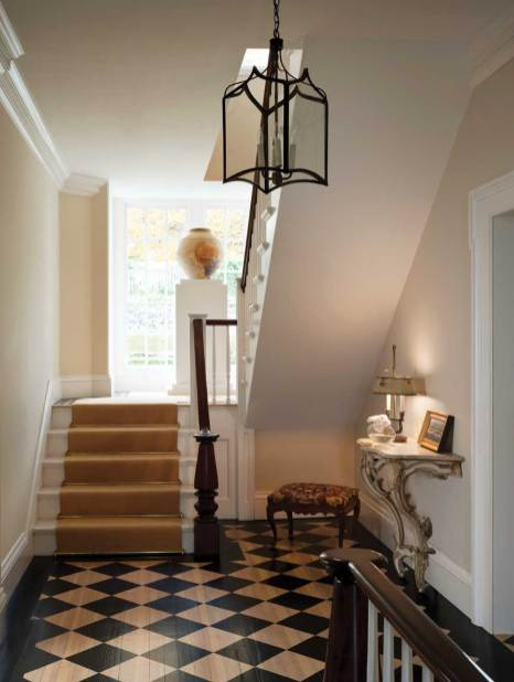 A checkerboard-painted floor and sisal runner mix with a rococo demilune.