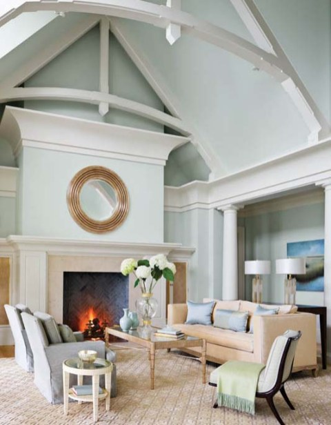 The living features arched trusses, oversize cove molding and classic columns and wears a palette of sea and sky colors