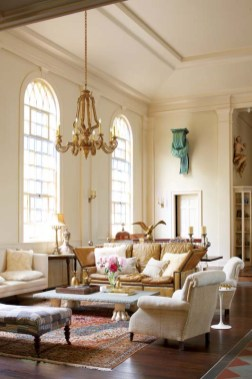 The living room retains vestiges of its former life as a church with its high ceilings and subtly stained glass windows.
